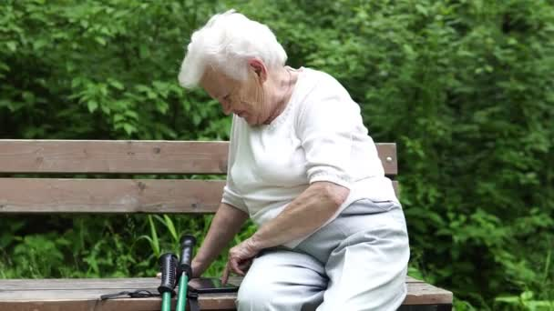 old granny looks at Internet smartphone