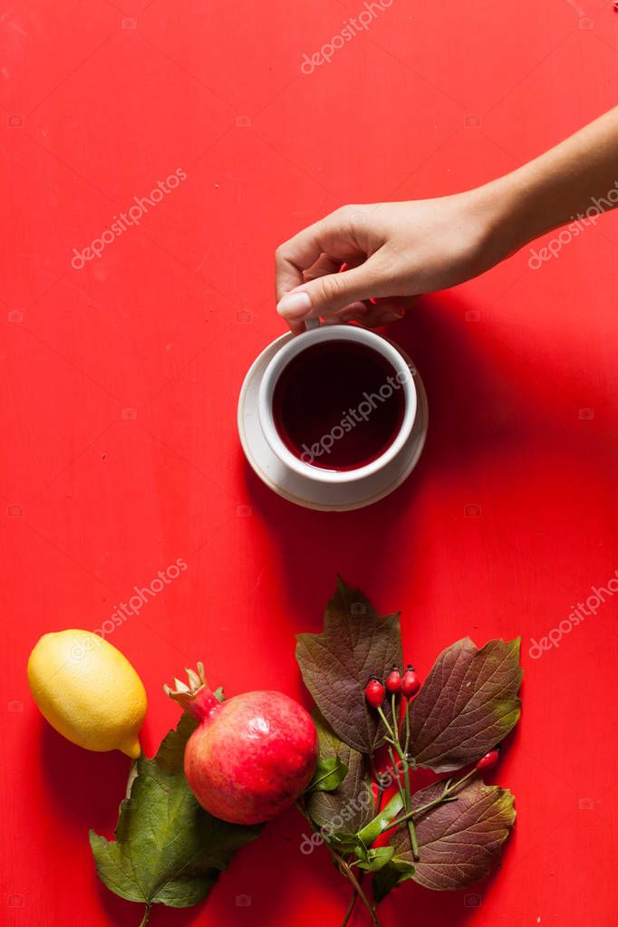 Cup of tea autumn leaves background fruits nuts