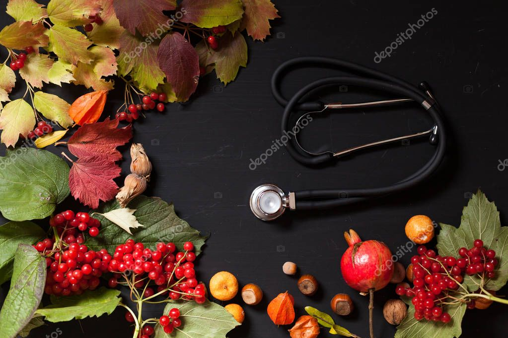 medicine stethoscope and yellow red autumn leaves