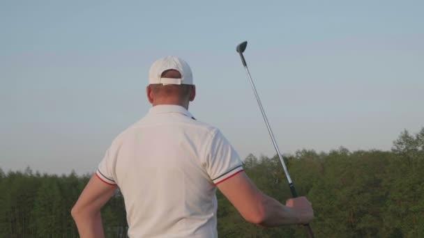 Male golfer golf club course.