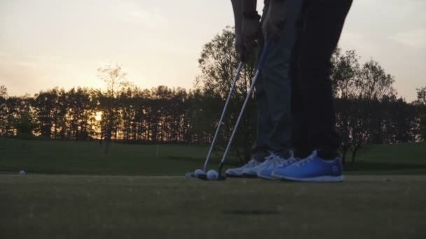 Slow Motion Shot Of Golfers Putting Ball On Green