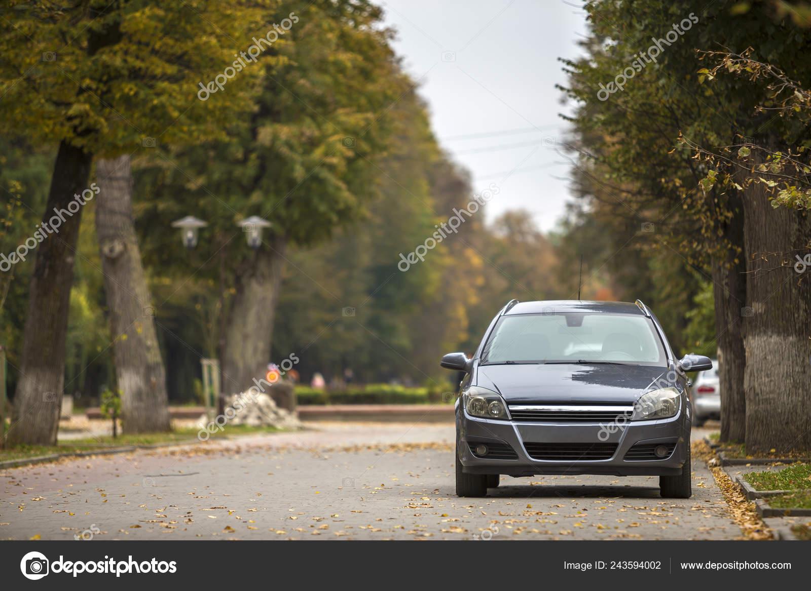 Gray Shiny Car Parked Quiet Area Asphalt Road Blurred Bokeh Stock Editorial Photo C Bilanol I Ua 243594002