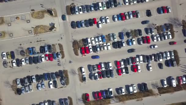 Top aerial view of many cars on a parking lot or sale car dealer market.