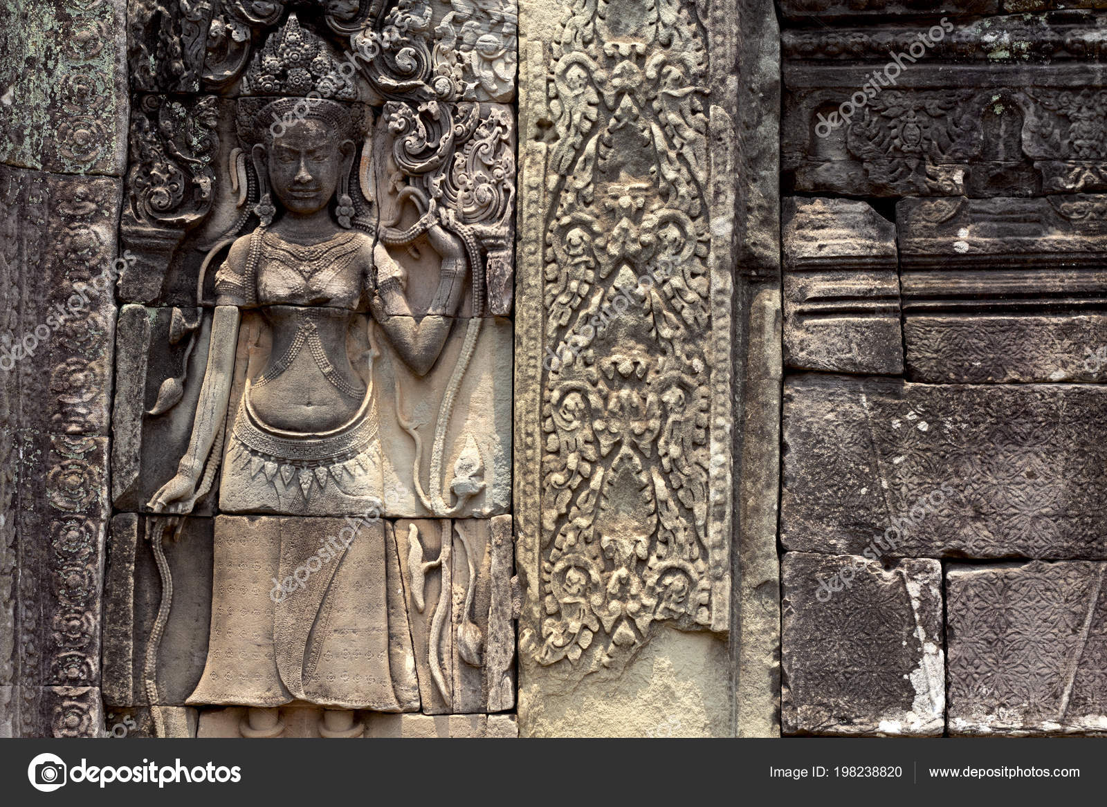 Carved stone bas relief angkor wat complex temple siem reap