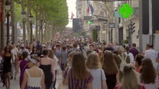 Paris,France,June 2018 : People walking on the famous Avenue de Champs-Elysees
