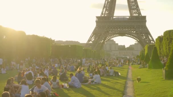 Paris,France - June 2018 : Eiffel tower daily in Paris. The Eiffel tower is the most visited monument of France. People are resting around the Eiffel tower.