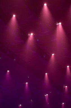 Lights through the smog on a concert