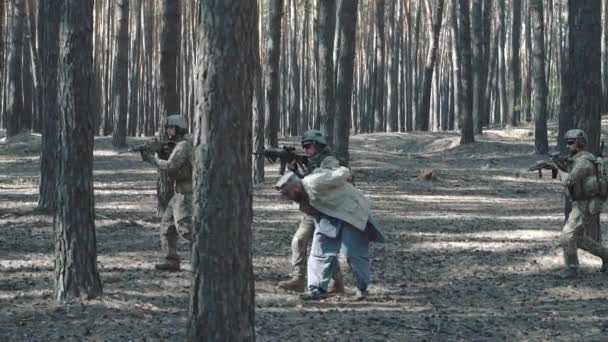Soldiers of the United States escort a captured mujahid terrorist in the forest
