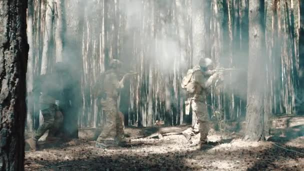 US Army soldiers patrol in a smoky forest