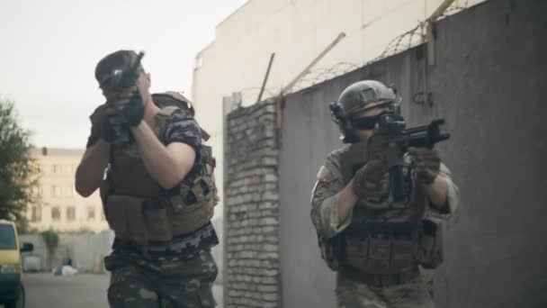 Military patrols the industrial zone during urban battles