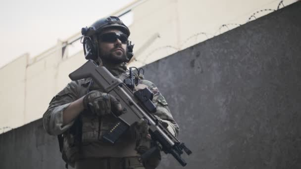 Portrait of an American soldier in the industrial zone