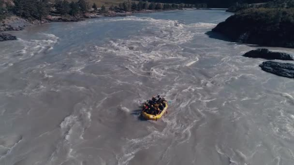 aerial. rafting on a mountain river. Whitewater rafting team descending raging rapids
