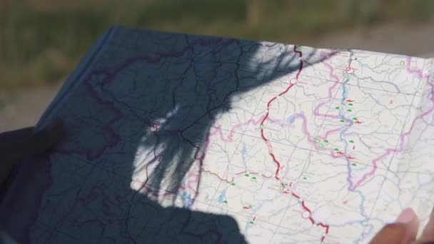 a map of the locality in the hands of a tourist close-up.