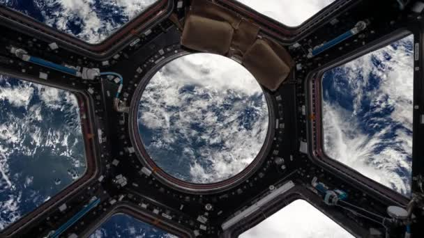 view from the porthole of the space station on planet earth