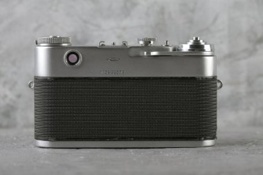 MOSCOW, RUSSIA, MAY 24, 2017. The old Soviet rangefinder camera Zorki-5, released 1958 on gray cement background.