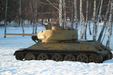 SNEGIRI SETTLEMENT, ISTRA DISTRICT, MOSCOW REGION, RUSSIA MARCH 17, 2019. Medium tank T 34-85 in the snow under the trees participated in the 2nd world war.