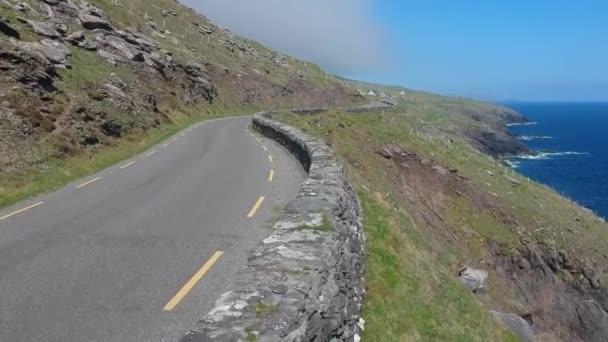 Amazing winding street along the coast line of Dingle Peninsula in Ireland - aerial shot