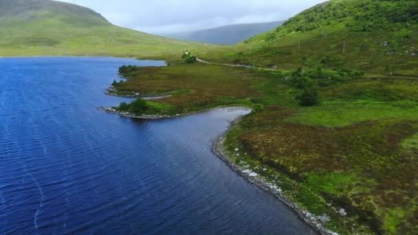 Beautiful blue lakes in the Highlands of Scotland - aerial drone flight