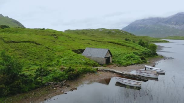 Flight over small lakes and creeks in the highlands of Scotland