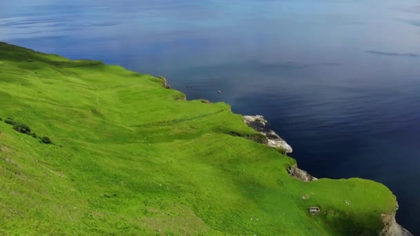 Flight over the green coastline and cliffs on the Isle of Skye in Scotland