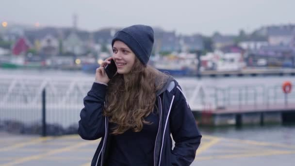 Beautiful girl calls her friend on the cellphone
