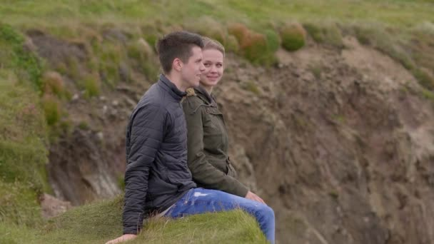 Two friends enjoy the silence at the west coast of Ireland