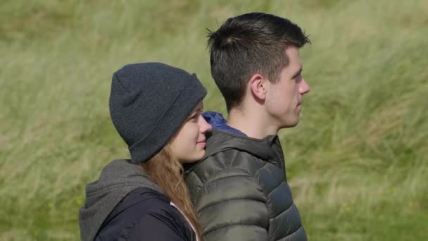 Young couple in love enjoys the amazing nature of Ireland