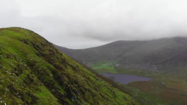 Amazing flight over a valley at Dingle Peninsula in Ireland