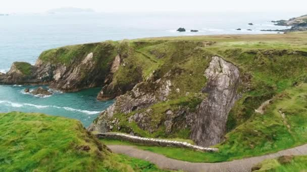 Amazing flight over the rough coast of Dunquin Pier in Ireland