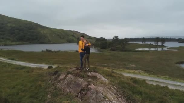 Young couple enjoy the amazing Irish landscape