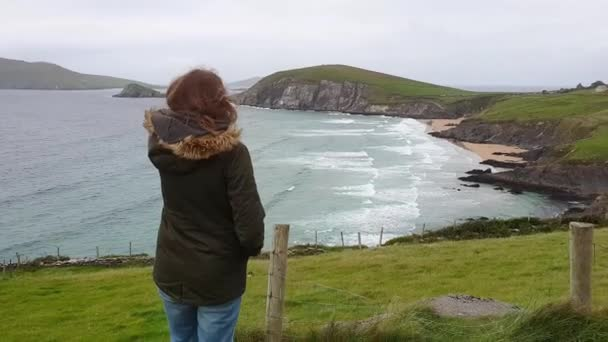 Young woman is excited by the amazing nature of Ireland