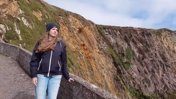 Young woman loves to walk through the amazing landscape of Ireland