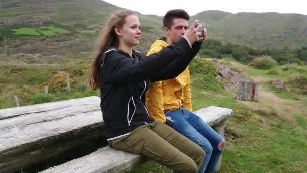 Pretty girl takes photos of the amazing Irish landscape