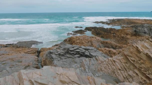 The rocky beach of Bedruthan Steps in Cornwall - an amazing landmark at the Cornish Coast