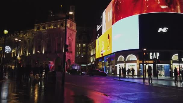 London Piccadilly Circus at night is a popular place - LONDON, ENGLAND - DECEMBER 16, 2018