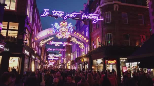 Colorful Carnaby Street in London at Christmas Time - LONDON, ENGLAND - DECEMBER 16, 2018