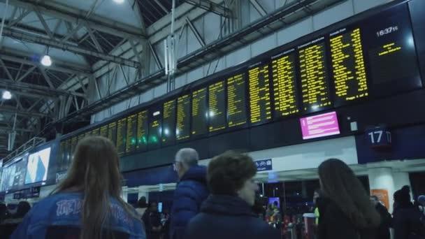 Huge departure time table at Waterloo station London - LONDON, ENGLAND - DECEMBER 16, 2018