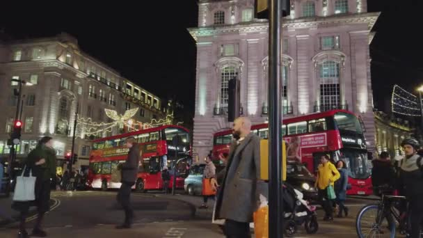 London street view by night at Piccadilly Circus - LONDON, ENGLAND - DECEMBER 16, 2018
