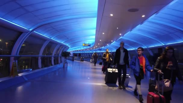 Walkway between terminals at the airport - MANCHESTER, UNITED KINGDOM - JANUARY 1, 2019