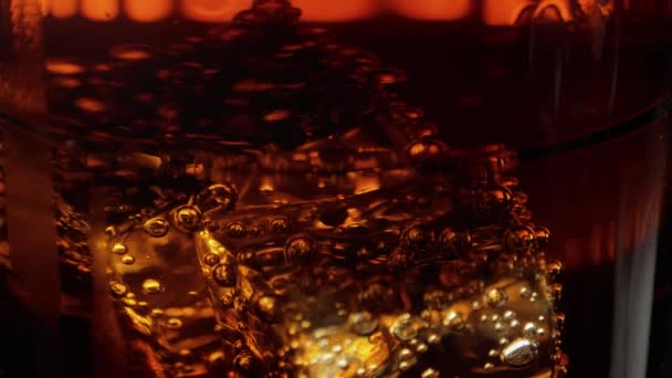 Amazing shot of ice cubes in Cola - perfect background of refreshing soda