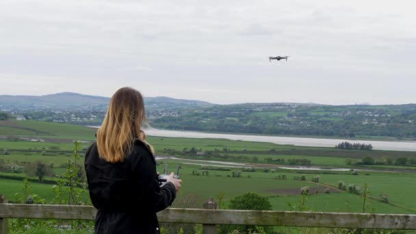 Young woman flying a drone in Ireland - travel photography