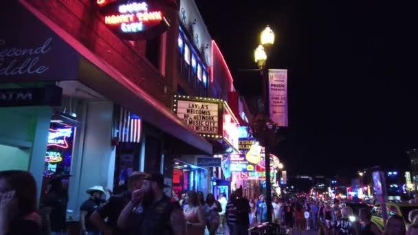Walking over Broadway in Nashville by night - NASHVILLE, TENNESSEE - JUNE 16, 2019