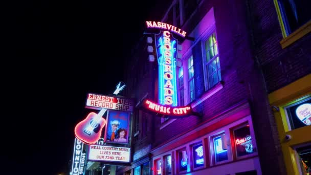 Walking over Broadway in Nashville by night - NASHVILLE, TENNESSEE - JUNE 16, 2019
