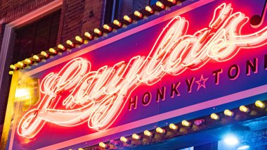 Colorful neon signs on Nashville Broadway at night - NASHVILLE, TENNESSEE - JUNE 15, 2019