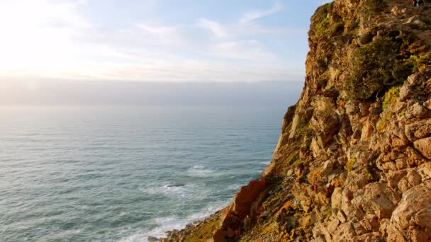 The rocky coast of Cape Roca in Portugal at the Atlantic Ocean - travel footage