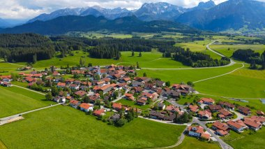 The village of Eisenberg in Bavaria Allgau in the German Alps. Aerial view stock vector