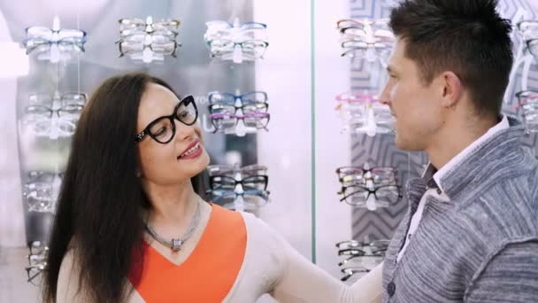shop glasses, optics, beautiful couple with poor eyesight, choose their own glasses, rims glasses. Happy couple trying on glasses in shop, Optical Store. health care concept
