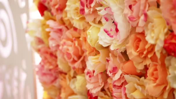close-up, wedding decor, festive decoration with buds of roses, beautiful wall of buds of orange, peach roses