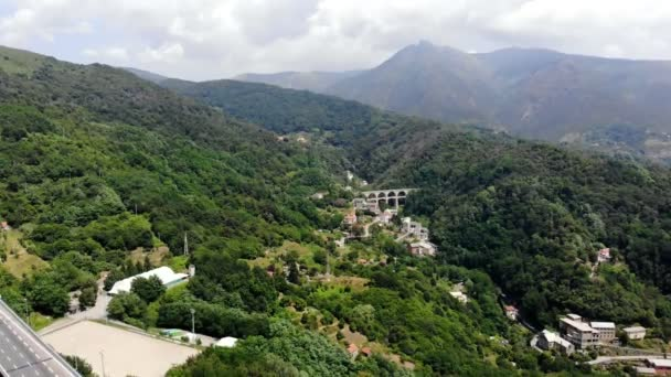 OVADA, ITALY - JULY 7, 2018: beautiful landscapes, landscapes, views of Italy. in the distance a large bridge is seen, towering over a cliff, connecting two mountains. aero