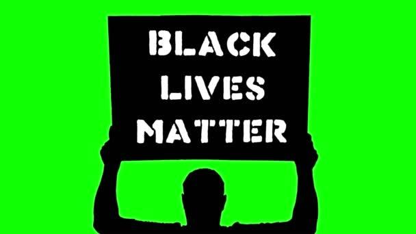 Animace. Černá silueta chráněnce drží plakát s praporem nad hlavou, se sloganem - Černá hmota. Zelené pozadí. Protest na podporu práv a svobod černochů v USA a